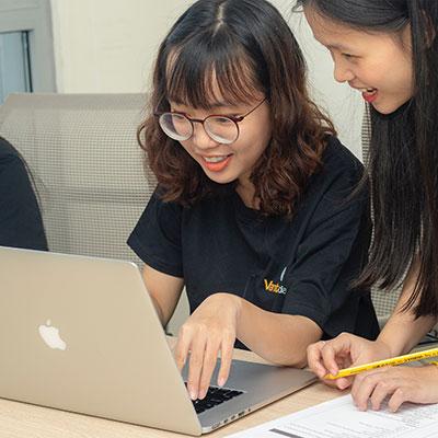 two girls on laptop